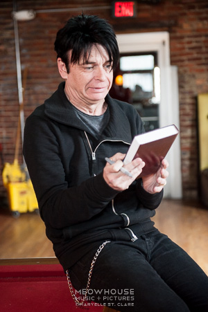 Gary Numan signs a Bible - Nashville, 17 Mar 2014